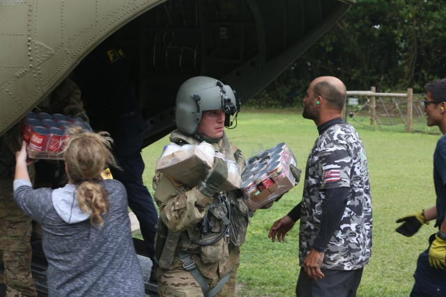 25th Infantry Division Soldiers transported emergency vehicles, food, water, bedding, hygiene products and other supplies to Kauai April 16-17 after severe rains, flooding and mudslides stranded hundreds of residents and tourists in Kauai, Hawaii. Soldiers transported people stranded to Camp Naue near Princeville, Kauai. 25th Inf. Div. aviation assets were tasked to support relief efforts after the state requested assistance through U.S. Pacific Command. (U.S. Army photo by Staff Sgt. Keith Anderson, 25th Infantry Division Public Affairs)