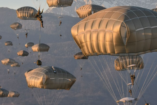 The skies are filled with Soldiers from the 173rd Airborne Brigade as hundreds of paratroopers conduct a tactical airborne insertion onto Juliet Drop Zone, Pordenone, Italy. The case of EMC, which turns aircraft into flying command posts on the way to the paratroopers' objectives, shows that acquisition can move fast—it took only two years to go from idea to complete fielding.