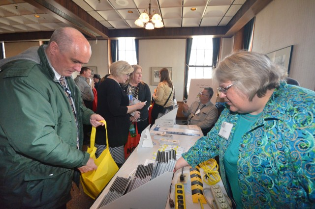 Gail Tutt, president of the U.S. Army Joint Munitions Command Employee Safety Committee, chats with a participant at the RIA Safety display at the inaugural People First Forum at Rock Island Arsenal, April 17. (Photo by Galen Putnam, Army Sustainment Command Public Affairs)