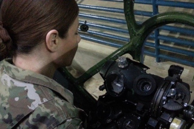 FORT BENNING, Ga. (April 19, 2018) -- Maj. Marylane Garcia, student at the Army Command General and Staff College (CGSOC) at the Western Hemisphere Institute for Security Cooperation (WHINSEC), looks at a Norden bombsight at the B-29 Superfortress bombardier station, during the CGSOC's April 11 visit to the Museum of Aviation at Robins Air Force Base, Georgia. (Courtesy photo)