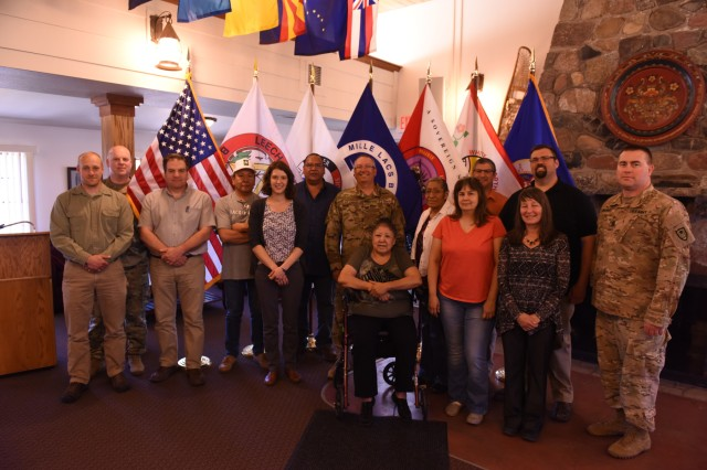 Group photo of the attendees of this year's Tribal Consultation at Camp Ripley, Minnesota. In attendance were Dakota and Ojibwe Representatives from 5 Tribes.  The Flags of all of the Federally Recognized Tribes in the state have been acquired by the MNARNG to display during official functions that they are present at.