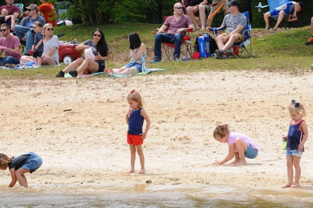 Children play at West Beach during Thunder on Tholocco April 14.