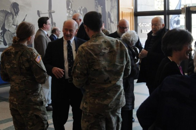 """Holocaust survivor Mr. Werner Gossels speaks with Soldiers following a Holocaust observance. Lewy was the keynote speaker of the event, titled the """"Legacy of Perseverance,"""" which was held at Natick Soldier Systems Center (NSSC) April 11, 2018."""