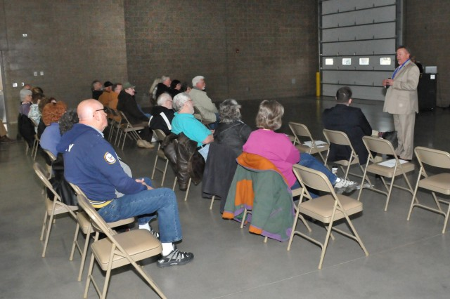 Randy Doyle, Iowa Army Ammunition Plant, Environmental Coordinator, briefs the plant's building demolition and restoration projects to more than 50 community members during Earth Day Open House on April 18.