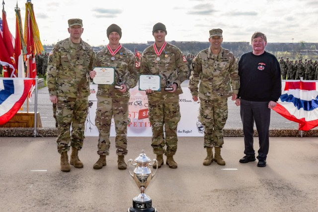 The 2nd Place finishers of the 2018 Lt. Gen. Robert B. Flowers Best Sapper Competition, 1st Lt. Thomas Hoyt and Sgt. Gary Coggins, 1st Engineer Battalion, 1st Armored Brigade Combat Team, Fort Riley, Kansas, representing Team 23, are announced during a ceremony held April 19, 2018, at Fort Leonard Wood's Gammon Field. Pictured from left: Command Sgt. Maj. Trevor Walker, U.S. Army Engineer School regimental command sergeant major; 1st Lt. Thomas Hoyt; Sgt. Gary Coggins; Brig. Gen. Robert Whittle Jr., U.S. Army Engineer School commandant, and 50th Chief of Engineers, Lt. Gen. Robert Flowers, retired.
