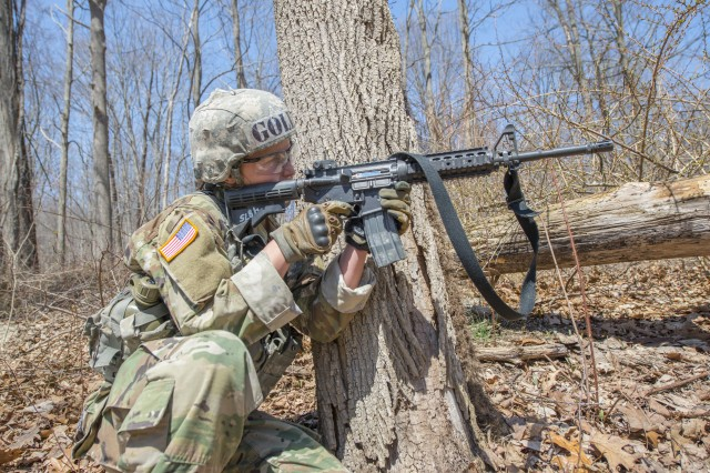 Cadet Taylor England fires her M4 carbine at a target during the Sandhurst Military Skills Competition at West Point, New York, April 14, 2018. England, the top-ranked cadet who is branching Infantry, plans to serve with the 173rd Airborne Brigade when she completes the Infantry basic officer leader course.