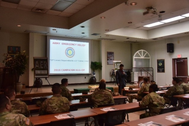 Mr. Bobby Kim, Acting Financial Readiness Program Manager, explains the purpose of Army Emergency Relief. (U.S. Army photo by Pvt. Yoo, Jin-ho)
