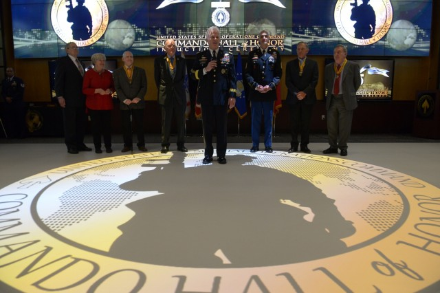 U.S. Army Gen. Raymond A. Thomas III, U.S. Special Operations Command commander, and Sgt. Maj. Patrick McCauley, USSOCOM command sergeant major stand with the six newest members inducted into the Commando Hall of Honor during a ceremony at USSOCOM headquarters, MacDill Air Force Base, Fla., April 18, 2018. The Commando Hall of Honor was created in 2010 and recognizes individuals who have served with distinction within the special operations forces community. Photo by U.S. Air Force Master Sgt. Barry Loo.