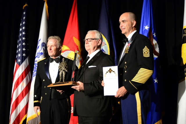 "Retired U.S. Army Sgt. Maj. Dennis Wolfe receives U.S. Special Operations Command's 2018 Bull Simons Award April 18, from Gen. Raymond A. Thomas, III, commander, USSOCOM in Tampa, Florida. His remarkable five decade career in and out of uniform pioneering explosive ordnance and disposal tactics for special operations was the basis for the award. His expertise established a world class program to counter weapons of mass destruction becoming the standard for the U.S. government and our international partners. The lifetime achievement award recognizes recipients who embody the true spirit, values, and skills of a special operations warrior. Col. Arthur ""Bull"" Simons, whom the award is named after, was the epitome of these attributes. Courtesy of retired Sgt. Maj. Dennis Wolfe. Photo by Michael Bottoms, USSOCOM Office of Communication."