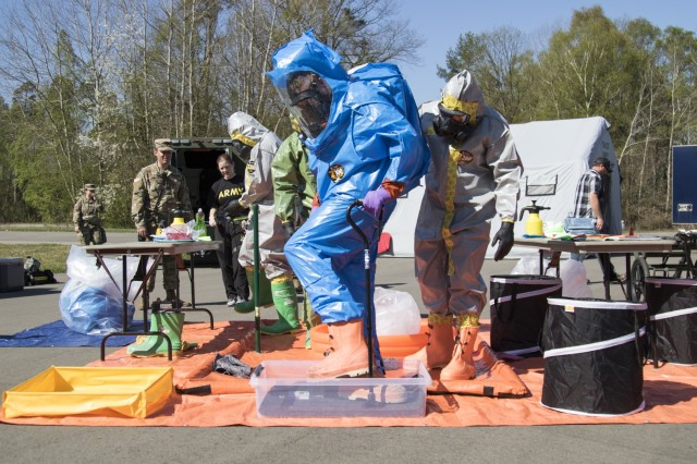 U.S. Army Reserve Soldiers with the 773rd Civil Support Team, 361st Civil Affairs Brigade, simulate decontamination procedures during a Chemical, Biological, Radiological and Nuclear (CBRN) exercise at Ramstein Air Base, Germany, April 19. The training was facilitated by a mobile training team from Dugway Proving Ground, Dugway, Utah, and improved CBRN readiness capabilities, knowledge, response and ability to execute core unit functions. (U.S. Army Reserve Photo by Spc. Daisy Zimmer, 221st Public Affairs Detachment)