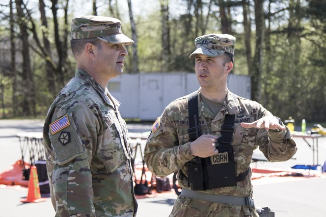 U.S. Army Reserve Cpt. Dino De La Hoya, operations officer with the 773rd Civil Support Team, 361st Civil Affairs Brigade, discusses learning objectives with Col. Bradley Heston, brigade commander of 361st Civil Affairs Brigade during a Chemical, Biological, Radiological and Nuclear (CBRN) exercise at Ramstein Air Base, Germany, April 19. The training was facilitated by a mobile training team from Dugway Proving Ground, Dugway, Utah, and improved CBRN readiness capabilities, knowledge, response and ability to execute core unit functions. (U.S. Army Reserve Photo by Spc. Daisy Zimmer, 221st Public Affairs Detachment)