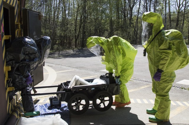 U.S. Army Reserve Soldiers with the 773rd Civil Support Team, 361st Civil Affairs Brigade, begin a training scenario during a Chemical, Biological, Radiological and Nuclear (CBRN) exercise at Ramstein Air Base, Germany, April 19. The training was facilitated by a mobile training team from Dugway Proving Ground, Dugway, Utah, and improved CBRN readiness capabilities, knowledge, response and ability to execute core unit functions. (U.S. Army Reserve Photo by Spc. Daisy Zimmer, 221st Public Affairs Detachment)