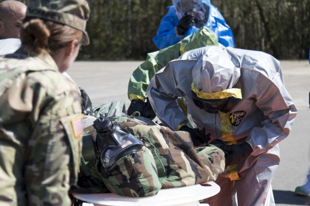 U.S. Army Reserve Soldiers from the 773rd Civil Support Team, 361st Civil Affairs Brigade, practice decontamination procedures on a simulated casualty during a Chemical, Biological, Radiological and Nuclear (CBRN) exercise at Ramstein Air Base, Germany, April 19. The training was facilitated by a mobile training team from Dugway Proving Ground, Dugway, Utah, and improved CBRN readiness capabilities, knowledge, response and ability to execute core unit functions. (U.S. Army Reserve Photo by Spc. Daisy Zimmer, 221st Public Affairs Detachment)