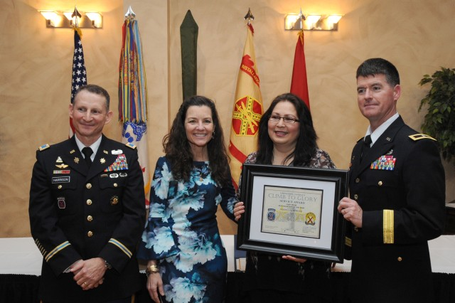 Guadalupe Moreno (third from left) receives the 2018 Fort Drum Volunteer of the Year award from Col. Kenneth D. Harrison, Fort Drum garrison commander, Cynthia Piatt, wife of Maj. Gen. Walter E. Piatt, 10th Mountain Division (LI) and Fort Drum commander, and Brig Gen. Patrick Donahoe, 10th Mountain Division (LI) deputy commanding general. Soldiers, Family Members and Civilians from across the Fort Drum community were honored for their selfless service April 19 during the annual Volunteer of the Year appreciation ceremony at the Commons.