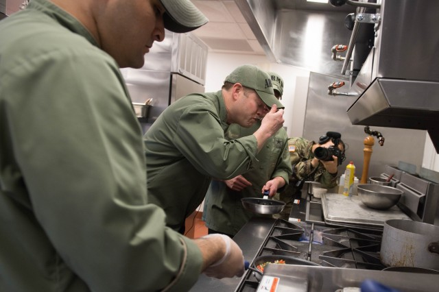 Undersecretary of the Army Ryan D. McCarthy tastes the dish he prepared during a cook-off in the Army Executive Dining Facility against Chef Robert Irvine, April 20, 2018, in the Pentagon.