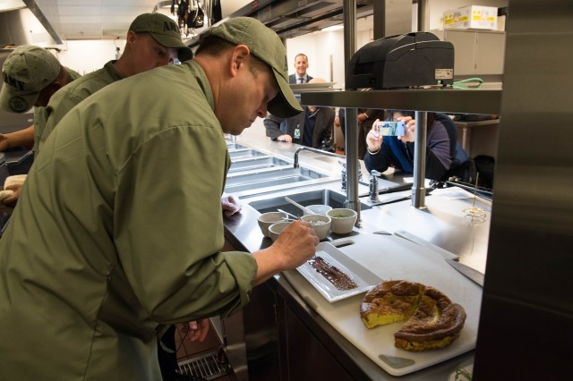 Undersecretary of the Army Ryan D. McCarthy prepares his dish during a cook-off in the Army Executive Dining Facility against Chef Robert Irvine, April 20, 2018, in the Pentagon.