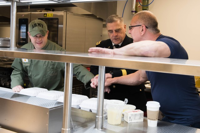 Undersecretary of the Army Ryan D. McCarthy, left, hosted a visit with Chef Robert Irvine, right, with the Army Executive Dining Facility staff, where they participated in a cook-off at the Pentagon, Washington D.C., April 20, 2018. Army Chief of Staff Gen. Mark A. Milley, center, was an unofficial judge for the cook-off.