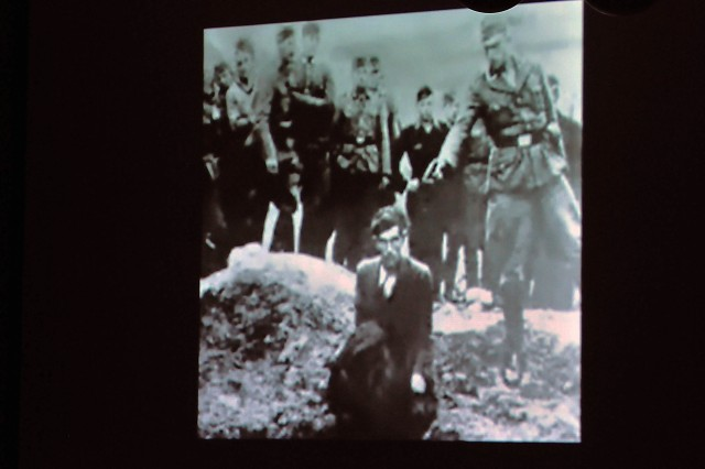 "Shown is a photo from a video titled ""Why We Remember"" that was part of the observance. The video intercut between interviews and photos of Jewish people being persecuted in public and the deadly, tortuous conditions of concentration camps. (Photo by Jon Micheal Connor, ASC Public Affairs)"