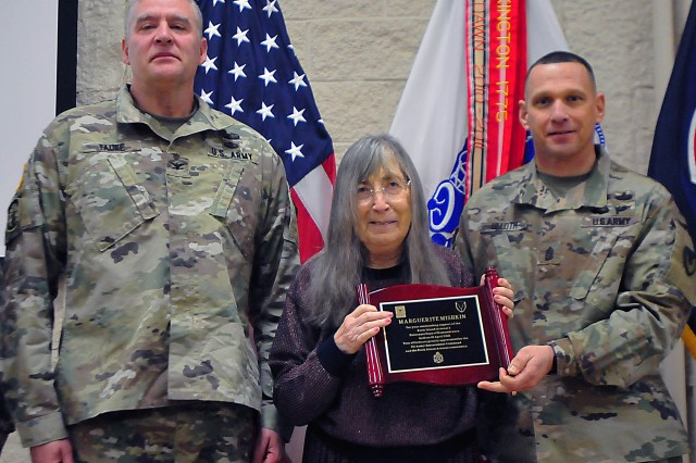 Marguerite Mishkin, Holocaust child survivor, displays her appreciation plaque flanked by U.S. Army Sustainment Command's Command Sgt. Maj. Joe Ulloth (right) and RIA Garrison Commander Col. Kenneth Tauke. (Photo by Jon Micheal Connor, ASC Public Affairs)