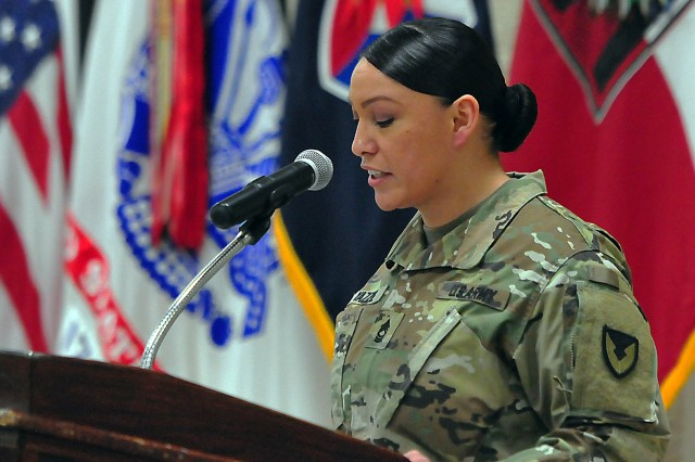 "Emcee Master Sgt. Chrystal Yazzie, U.S. Army Sustainment Command, provides some historical facts on the Holocaust to attendees at RIA's ""Holocaust Days of Remembrance Observance"" April 18 at Heritage Hall. (Photo by Jon Micheal Connor, ASC Public Affairs)"