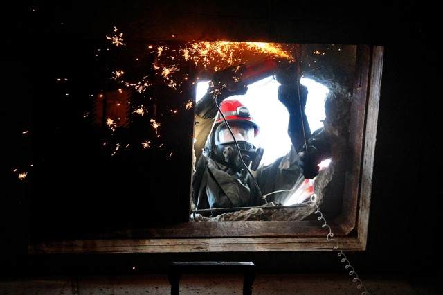 An Army Reserve Soldier with the 468th Engineer Detachment, based in Danvers, Mass., cuts through a concrete opening to enter a confined space during a collapsed subway extrication at the Army Reserve's Guardian Response 18 exercise, April 11, 2018. More than 4,500 Soldiers from across the country participated in GR18, a multi-component training exercise to validate U.S. Army units' ability to support the Defense Support of Civil Authorities in the event of a Chemical, Biological, Radiological and Nuclear catastrophe. The training audience brought a range of life-saving capabilities such as medical response, decontamination, technical rescue, patient evacuation, communications and logistics support to move people, equipment and supplies by land and air.