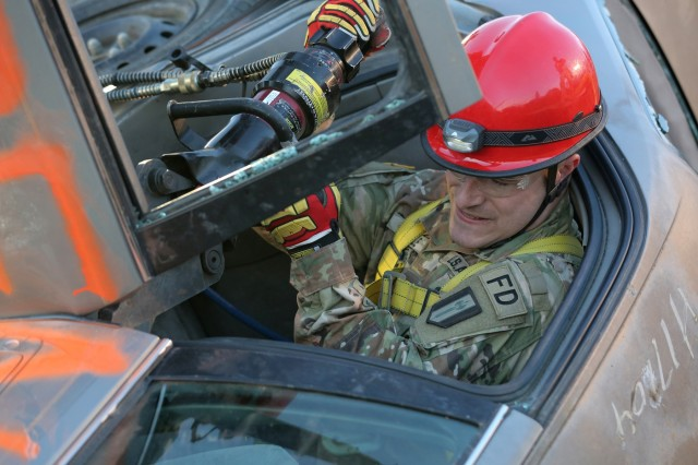 U.S. Army Reserve Sgt. Brian Cole, with the 468th Engineer Detachment, based out of Danvers, Mass., removes the door off of a vehicle during a trench rescue mission at the Army Reserve's Guardian Response 18 exercise, April 12, 2018. Cole serves as a firefighter in his military capacity as well as in his civilian one. More than 4,500 Soldiers from across the country participated in GR18, a multi-component training exercise to validate U.S. Army units' ability to support the Defense Support of Civil Authorities in the event of a Chemical, Biological, Radiological and Nuclear catastrophe. The training audience brought a range of life-saving capabilities such as medical response, decontamination, technical rescue, patient evacuation, communications and logistics support to move people, equipment and supplies by land and air.