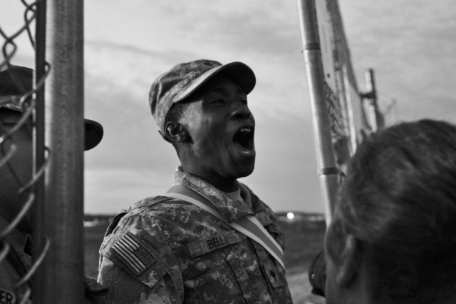 U.S. Army Reserve Spc. Stephan Bell yells out to screaming protesters during an hour and a half-long mock protest in front of the gates of Contingency Operating Base Panther at the Army Reserve's Guardian Response 18 exercise, April 13, 2018. Hundreds of live role-players and moulaged mannequins, and more than 4,500 Soldiers from across the country participated in GR18, a multi-component training exercise to validate U.S. Army units' ability to support the Defense Support of Civil Authorities in the event of a Chemical, Biological, Radiological and Nuclear catastrophe. The training audience brought a range of life-saving capabilities such as medical response, decontamination, technical rescue, patient evacuation, communications and logistics support to move people, equipment and supplies by land and air.