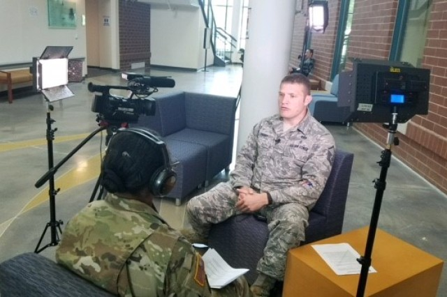 20170614-A-UH299-6368 -- Staff Sgt. Vannessa Josey, a student at the Electronic Journalism Course, conducts a mock television interview with Master Sgt. Nathan Parry, an instructor at the Defense Information School, Fort George G. Meade, Maryland. The exercise assists students in preparing for a real media event with real world scenarios during the month-long course.
