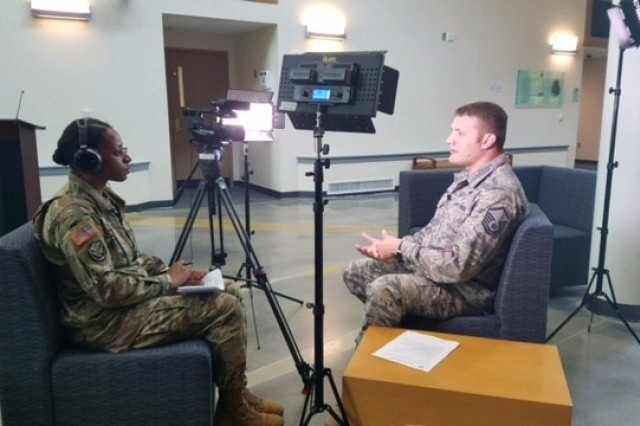 20170614-A-UH299-6367 -- Staff Sgt. Vannessa Josey, a student at the Electronic Journalism Course, conducts a mock television interview with Master Sgt. Nathan Parry, an instructor at the Defense Information School, Fort George G. Meade, Maryland. The exercise assists students in preparing for a real media event with real world scenarios during the month-long course