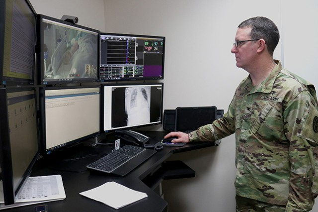 Col. John Kent, Madigan Army Medical Center's deputy commanding officer, takes a virtual critical care workstation for a spin April 18 at Madigan on Joint Base Lewis-McChord, Washington.