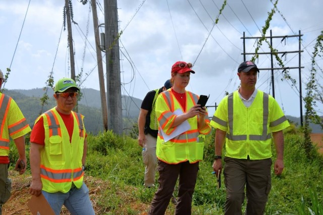 Michael Suh, (left) an environmental engineer with the USACE Seattle District, Tammy Turley (center), chief of the Regulatory Division at the USACE Nashville District, and Chris Akios, a biologist with the USACE Buffalo District, all temporarily assigned in Puerto Rico to evaluate compliance with environmental regulations, inspect sites where power restoration work is underway to assess conditions and make recommendations.