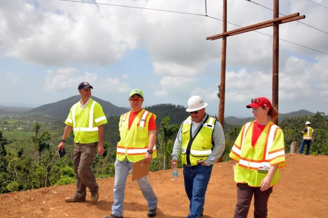 U.S. Army Corps of Engineers environmental science professionals, temporarily assigned in Puerto Rico to evaluate compliance with environmental regulations, inspect sites where power restoration work is underway to assess conditions and make recommendations.