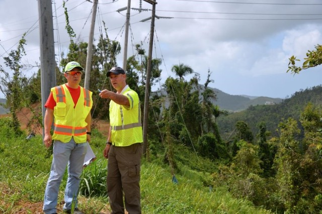 Michael Suh, (left) an environmental engineer with the USACE Seattle District and Chris Akios, a biologist with the USACE Buffalo District, both temporarily assigned in Puerto Rico to evaluate compliance with environmental regulations, inspect sites where power restoration work is underway to assess conditions and make recommendations.