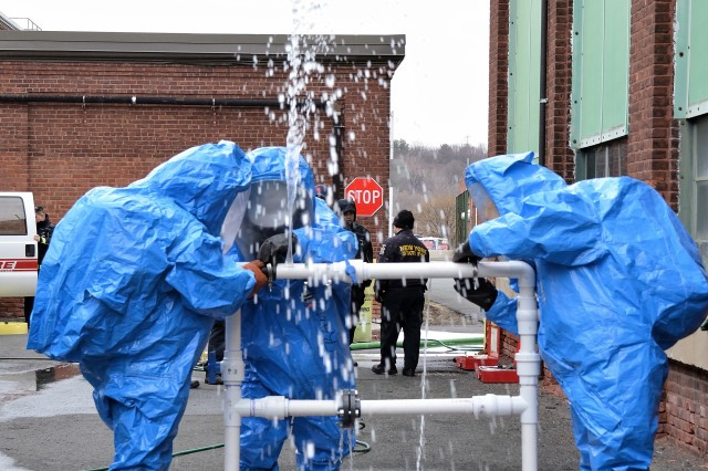 City of Troy first responders attempting to close a simulated chemical leak.