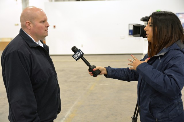 Spectrum News reporter Tessa Hickey, right, interviewing Arsenal Fire Chief John Whipple.