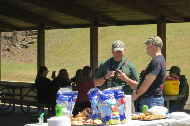 Colonel Philip Secrist enjoys lunch with the volunteers at the conclusion of the East Lynn Lake Cleanup. In all, 165 pounds of trash and debris weighing more than 5000 pounds was cleaned up by volunteers from Boy Scout Troop 62 from Barboursville and cadets from Wayne County High School.