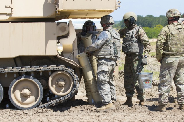 Soldiers from Battery B, 1st Battalion, 9th Field Artillery Regiment, 3rd Infantry Division Field Artillery, take rounds out of an M109A6 Paladin, April 13, 2017, on Fort Stewart, Ga. The battery recently received their first set of paladins as part of their battalion's conversion from a light to heavy armored battalion. (U.S. Army photo by Spc. Zoe Garbarino/Released)