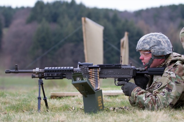 BAUMHOLDER, Germany -Sgt. Lionel Clark, Soldier with Headquarters and Headquarters Company, 361st Civil Affairs Brigade, shoots a M249B, light machine gun, during the familiarization stage of a four-day battle assembly, April 12. (U.S. Army Reserve photo by Capt. Jeku Arce, 221st Public Affairs Detachment)