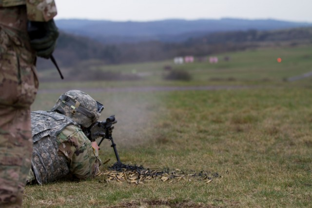 BAUMHOLDER, Germany -Sgt. Glenn Adams, Soldier with Headquarters and Headquarters Company, 361st Civil Affairs Brigade, shoots a M249B, light machine gun, during the familiarization stage of a four-day battle assembly, April 12. (U.S. Army Reserve photo by Capt. Jeku Arce, 221st Public Affairs Detachment)