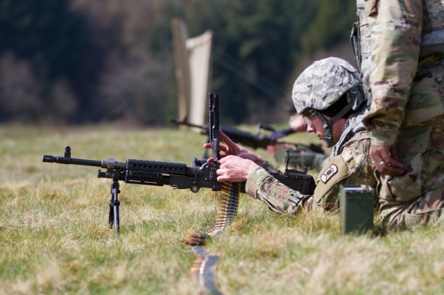 BAUMHOLDER, Germany -Spc. Daniel Miller, Soldier with Headquarters and Headquarters Company, 361st Civil Affairs Brigade, prepares to shoot a M249B, light machine gun, during the familiarization stage of a four-day battle assembly, April 12. (U.S. Army Reserve photo by Capt. Jeku Arce, 221st Public Affairs Detachment)