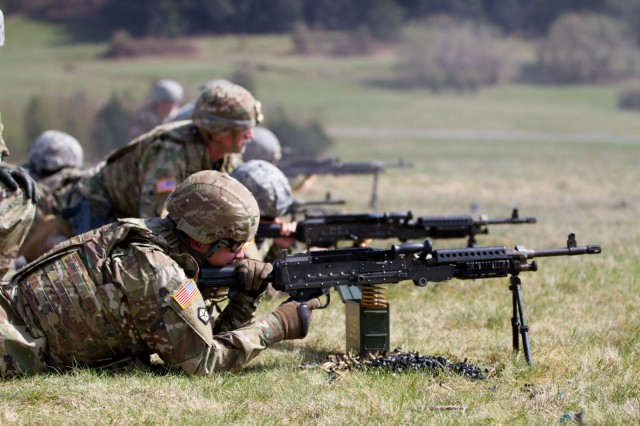 BAUMHOLDER, Germany -Soldiers from Headquarters and Headquarters Company, 361st Civil Affairs Brigade, fire M249Bs, light machine gun, during the familiarization stage of a four-day battle assembly, April 12. (U.S. Army Reserve photo by Capt. Jeku Arce, 221st Public Affairs Detachment)