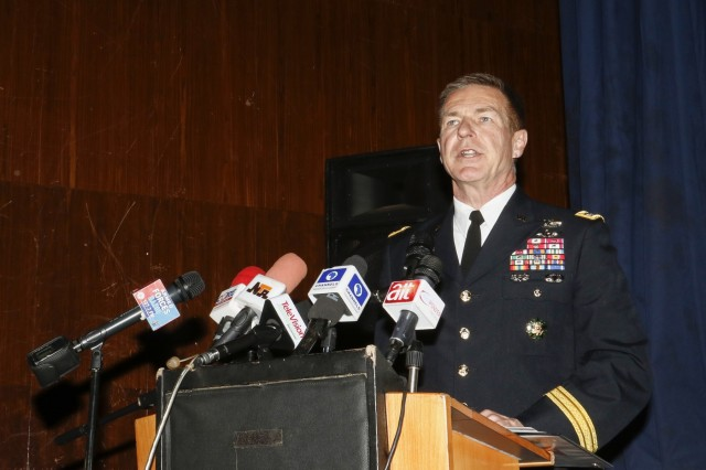 U.S. Army Gen. James C. McConville, 36th Vice Chief of Staff gives a few remarks at African Land Forces Summit Opening Ceremony in Abuja, Nigeria, Apr. 16, 2018. Forty African nations, NATO Allies, Department of State officials, Non Governmental Organizations, State Partnership Program Adjutant Generals, African Union, U.S. Africa Command, and other senior military leaders participated in this year's African Land Forces Summit  in Abuja, Nigeria, Apr. 16-20, 2018. ALFS 18 is a weeklong seminar bringing together land forces chiefs from across Africa for candid dialogue to discuss and develop cooperative and improve trans-regional security and stability. (U.S. Army photo by Spc. Angelica Gardner)