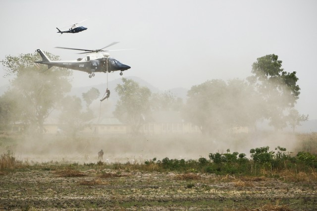 "Nigerian Special Force soldiers repel from a helicopter during operation ""Silent Kill""  military demonstration at African Land Force Summit in Abuja, Nigeria, April 17, 2018. ALFS 18 is a weeklong seminar bringing together land force chiefs from across Africa for candid dialogue to discuss and develop cooperative solutions and improve trans-regional security and stability. (U.S. Army photo by Spc. Angelica Gardner)"