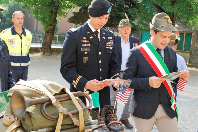 "VICENZA, Italy - U.S. Army Garrison Italy Headquarters Company commander Capt. Eric Ng, 30, from Los Angeles, Calif., represented the U.S. Army at the 73rd anniversary of Italian Liberation Day held at the ""Antonio Fogazzaro"" elementary school in Montegalda, Italy.  Ng presented American flags to the first graders as a sign of friendship.  ""We are grateful to have an American military officer here today to represent the U.S. Army Soldiers who helped free Italy and put an end to WWII,"" said Montegalda Mayor Andrea Nardin."