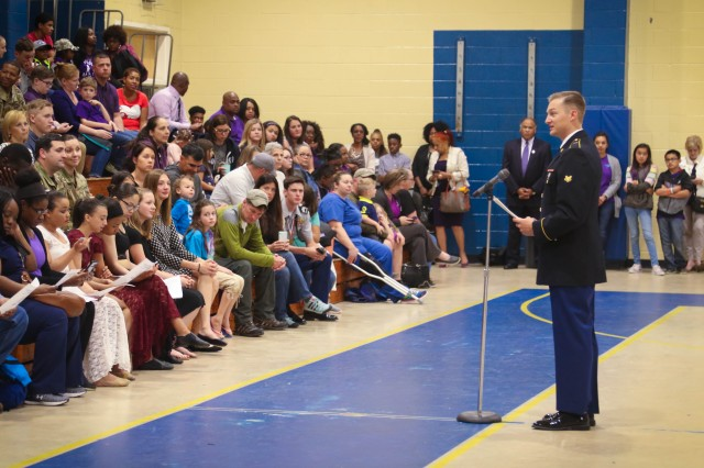 "Spc. Wesley Constandse, a geospatial engineer with the Headquarters and Headquarters Company, 525th Military Intelligence Brigade, Ft. Bragg, N.C. gives a speech about Military Children to students and parents at the Hoke County Schools Month of the Military Child Celebration, April 23, 2018 at East Hoke Middle School, Raeford, N.C. This event, in its eighth year, marks the first time since the celebrations inception which a military member was selected as the guest speaker. ""We wanted an Active Duty Soldier that has kids because his words come from the heart,"" said Iris Pierce, a school liaison officer. (U.S. Army photo by SSG Ondirae H. Abdullah-Robinson, 22nd MPAD)"