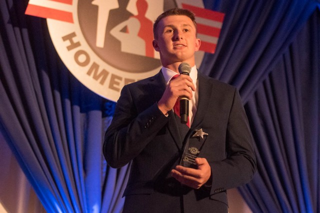 Aaron Hall, the 2018 Operation Homefront National Guard military child of the year, addresses the audience at a gala event held in Arlington, Va., April 19, 2018.