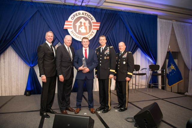 Aaron Hall, center, was recognized as the 2018 Operation Homefront National Guard military child of the year at a gala event held in Arlington, Va., April 19, 2018.  Lt. Gen Daniel R. Hokanson, the 11th Vice Chief of the National Guard Bureau and on Aaron's left, presented him with the award.