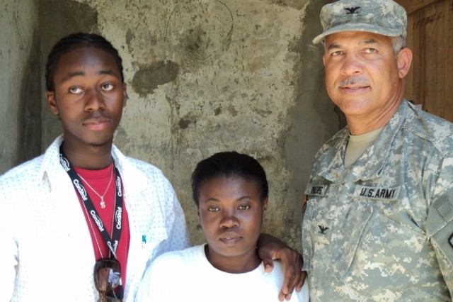 U.S. Army Reserve Col. Paul Phillips III (far right), orthopedic surgeon and chief of Professional Services with the 228th Combat Support Hospital at Joint Base San Antonio-Fort Sam Houston, is shown here during a deployment to Haiti in 2011.  Phillips practices medicine full time as part of the Orthopedic Surgery team at Hill Country Memorial Medical Group in Fredericksburg, Texas, and the 23-year military veteran is now a consultant to the U.S. Army Surgeon General, a role in which he's helping recruit orthopedic surgeons into the reserves.