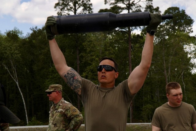Staff Sgt. Johnathan Werner, tank commander with Bravo Company, 3rd Combined Arms Battalion, 67th Armor Regiment, 2nd Armored Brigade Combat Team, 3rd Infantry Division, raises a 50 pound dummy round over his head during the tanker fitness assessment portion of the 2nd ABCT tank competition, April 18, at Fort Stewart, Ga. The competition was used to determine the crew that will represent 3rd ID at this year's Sullivan Cup scheduled for April 29 to May 4 at Fort Benning, Ga. Crews were assessed on their ability to accomplish eight tasks. Werner's crew placed first with a score of 1567.5 points out of a possible 2000. (U.S. Army photo by Spc. Leo Jenkins/ released)