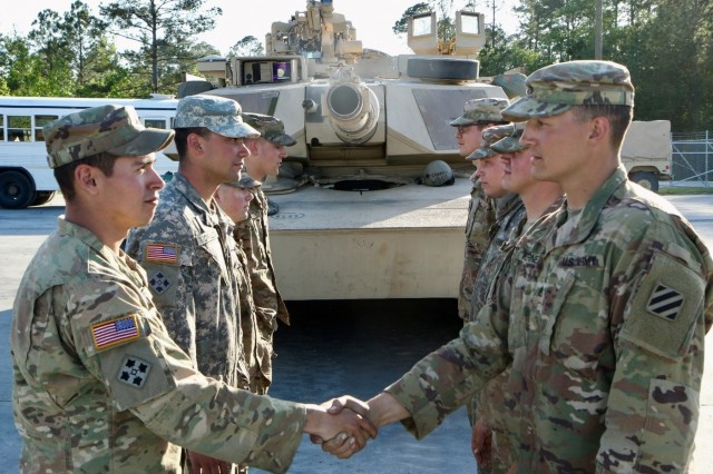 Both 1st and 2nd Armored Brigade Combat Teams of 3rd Infantry Division, shake hands after the announcement of the 2nd ABCT winning crew. This year the 3rd ID will be sending two teams to the U.S. Army Sullivan Cup. The Sullivan Cup is a highly competitive competition. It is scheduled to take place April 29 to May 4 at Fort Benning, Ga.